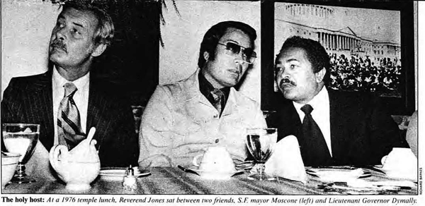The holy host: At a 1976 temple lunch, Reverend Jones sat between two friends, S.F. mayor Moscone (left) and Lieutenant Governor Dymally.