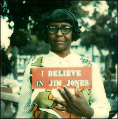 "Peoples Temple member holding an ""I believe in Jim Jones"" sign"